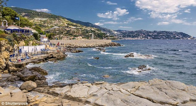Rocky retreat: Bordighera edges the blue waters where the Alps plunge into the Mediterranean Read more: http://www.dailymail.co.uk/travel/travelsupplement/article-4392914/Exploring-Italian-seaside-town-Bordighera.html#ixzz4ghfPntxF Follow us: @MailOnline on Twitter | DailyMail on Facebook